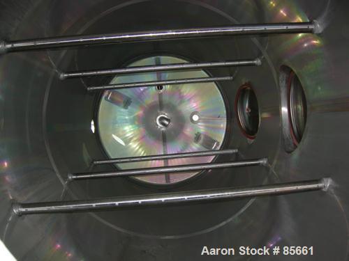 "USED: Reimelt pressure tank, 1849 gallon (7000 liter), 304 stainless steel, vertical. 64"" diameter x 138"" straight side, dis..."