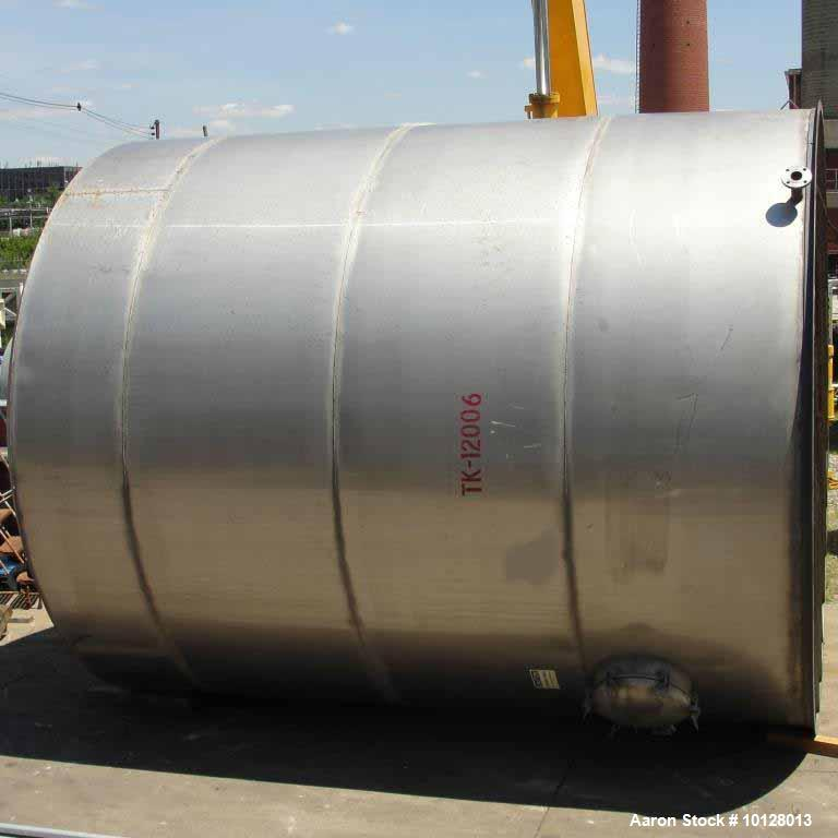 Used- 12,000 Gallon Vertical Stainless Steel Tank.