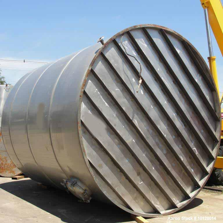 "Used- 12,000 Gallon Vertical Stainless Steel Tank. Dome Top and Sloped Bottom. Diameter is 144"", Height 174"", dome is 20"", s..."