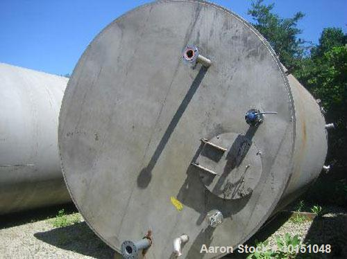 Used-approximate 10,000 gallon vertical 304 stainless steel tank with flat bottom head.