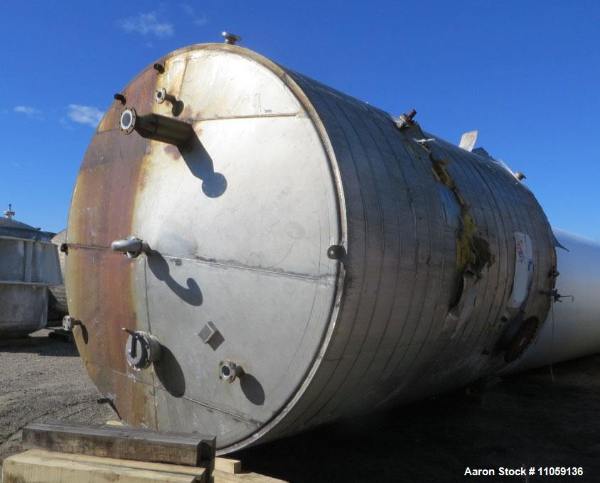 Used- Tate Metal Works 15,200 Gallon Stainless Steel Storage Tank. Approximately 12' diameter x 18' T/T. Flat bottom and con...