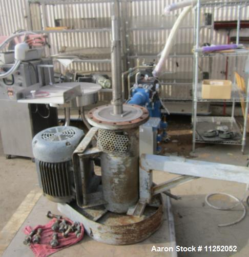 Used- Trumbo Welding Fabricating 13,900 Gallon 304 Stainless Steel Mix Tank. Bottom mounted heating / cooling coils. Tanks m...