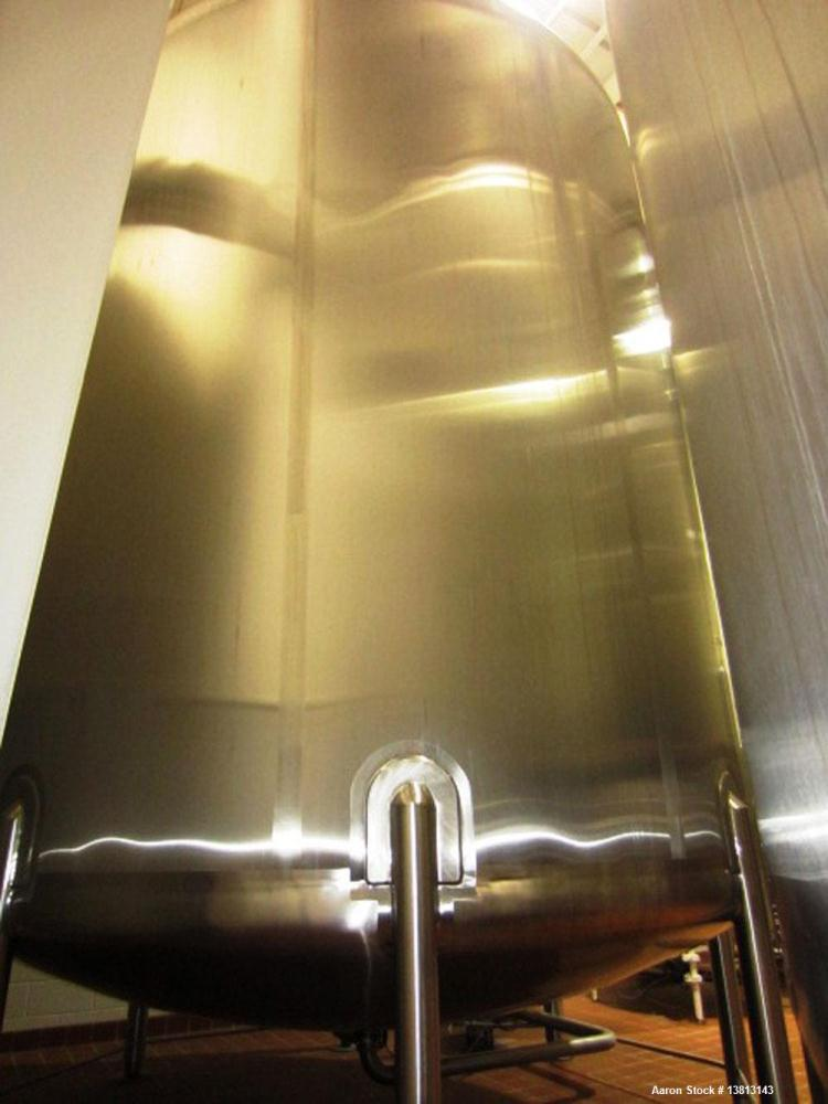 Used-Walker Stainless 10,000 Gallon top agitated type 304 stainless steel single wall mixing tank. Bottom side manway, dish ...