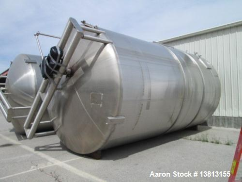 Used- Cherry Burell 15,000 Gallon, Vertical, All Stainless Steel Tank. Has top mounted agitator, flat bottom, dish top (dent...