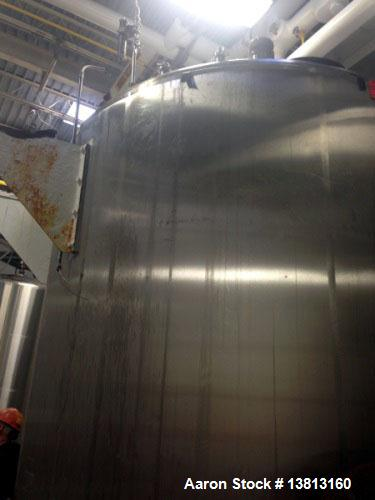 Used- Crepaco 6000 Gallon Jacketed Tank with Scrape Agitation. Stainless steel cone bottom tank. Sweep scrape aggitated and ...