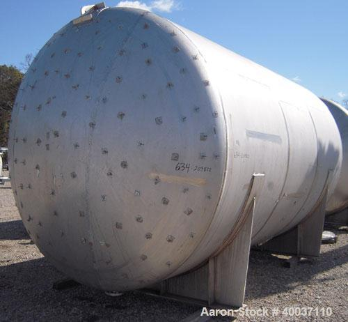 "Used: Douglas Brothers pressure tank, 8970 gallon, stainless steel, horizontal. Approximately 114"" diameter x 14' long, dish..."