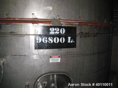 "Used- Westeel 25,608 Gallon (96,800 Liter) 304 Stainless Steel Storage Tank. Vertical Design. Approx. 12' Diameter x 31'6""  ..."