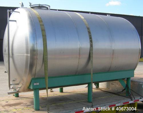 "Used- L'Hoir Incorporated tank, 4803 gallons (4000 Imperial), 304 stainless steel, horizontal. Approximately 94 1/2"" diamete..."