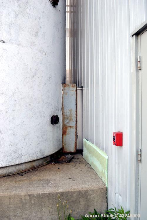 "Used- DCI Jacketed Silo, 3341 Cubic Feet (25,000 Gallon), Stainless Steel. Approximate 144"" Diameter x 35' tall. Dished top,..."