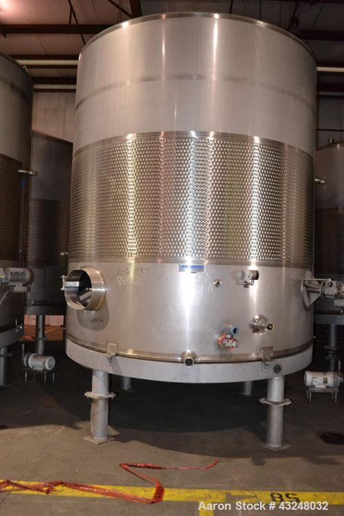 "Used- Mueller Tank, 6000 Gallon, Model DF, 304 Stainless Steel, Vertical. Approximate 118"" diameter x 126"" straight side. Of..."