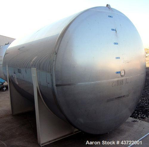 "Used- Custom Metalcraft Tank, 5000 Gallon, 304 Stainless Steel, Horizontal. Approximately 96"" diameter x 144"" straight side,..."
