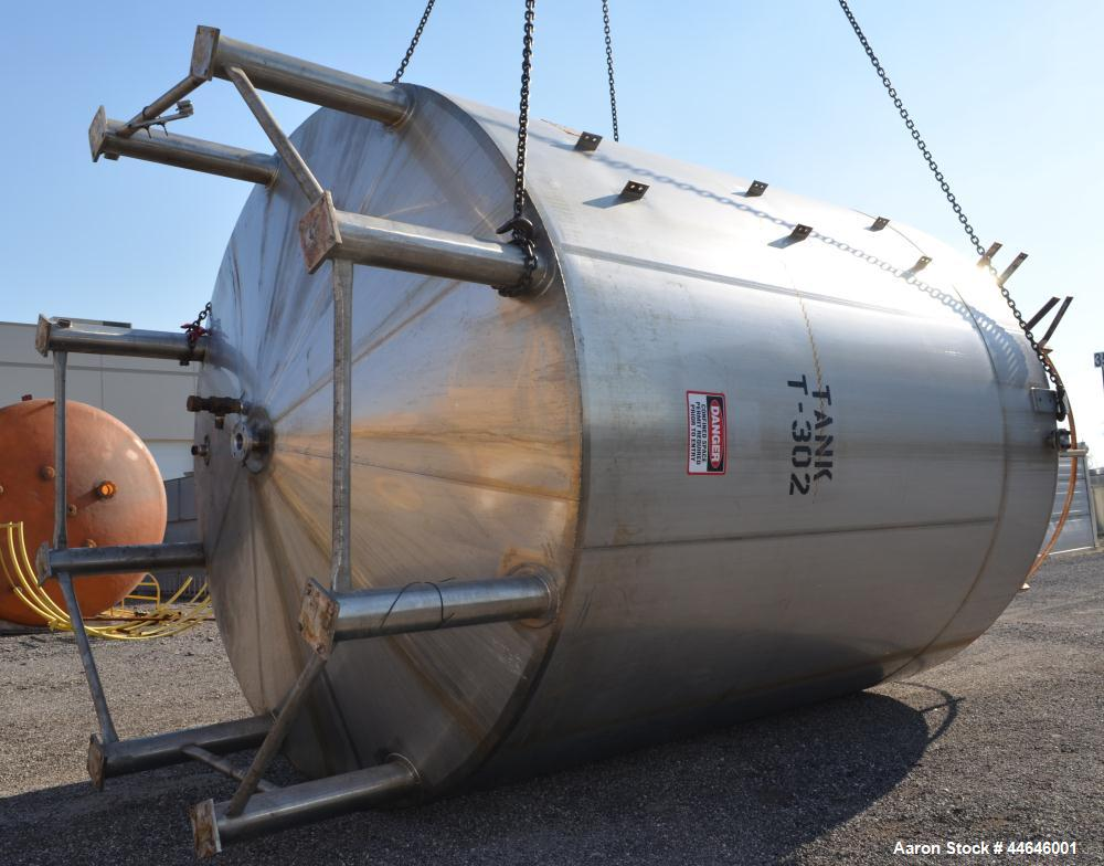 "Used- APV Crepaco Tank, Approximately 11,000 gallons, 304 Stainless Steel, Vertical. Approximate 138"" diameter x 164"" straig..."