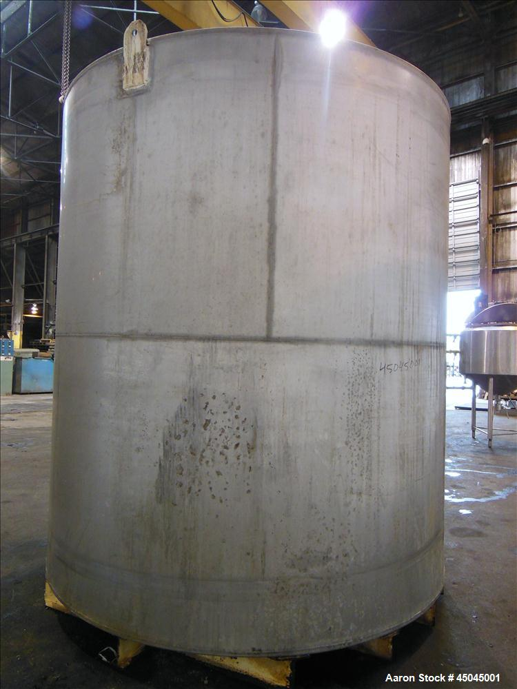 "Used- Tank, 5,000 Gallon, 304 Stainless Steel, Vertical. Approximate 112"" x 120"" straight side, slight coned top, flat botto..."