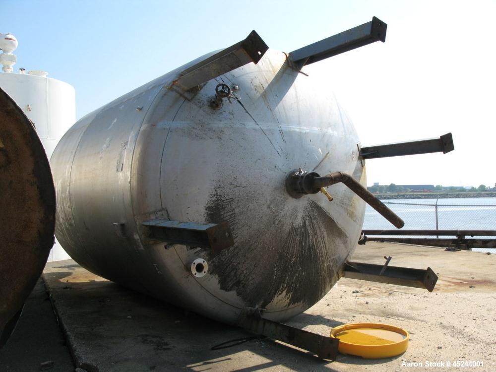 Used- Master Craft, 10,000 gallons vertical T304 stainless steel tank, heated with internal pipe coil. Tank is rated for 15 ...