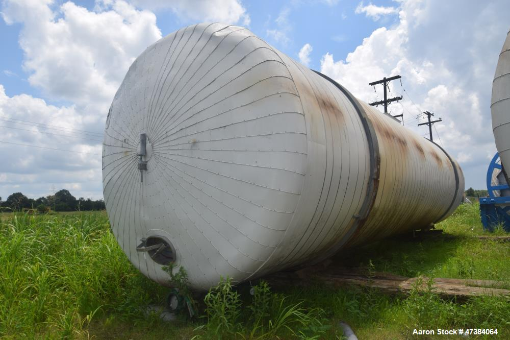 "Used- Mueller Tank, 45,000 Gallon, Model F, 304L Stainless Steel, Horizontal. Approximate 148-1/2"" diameter x 564"" straight ..."
