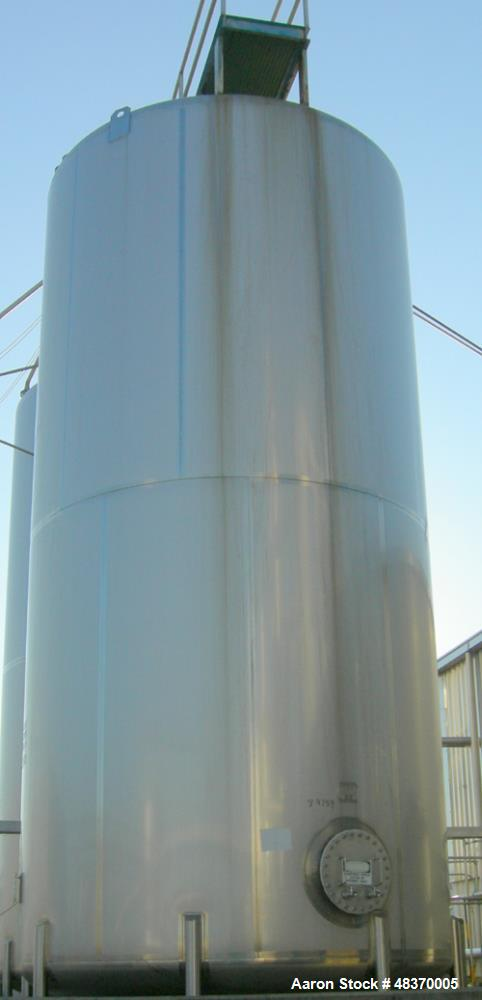 Used- Walker 21,000 Gallon, Type 304L Stainless Steel, Storage Tank. Vertical, dished heads, approximate 12' diameter x 24' ...