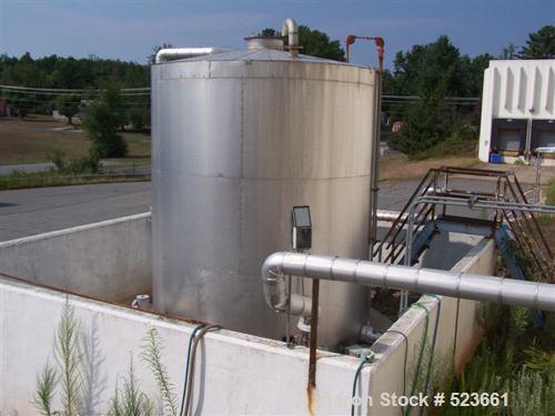 USED: 7,500 gallon, 304 stainless steel, vertical tank. Slight dishtop, flat bottom, 10' diameter x 13' overall height, insu...