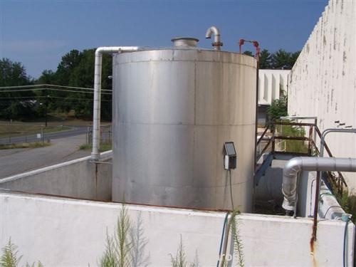 USED: 7500 gallon, 304 stainless steel, vertical tank. Slight dishtop, flat bottom, 10' diameter x 13' overall height, insul...