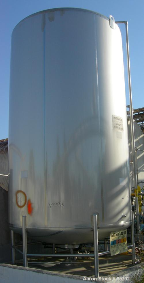 "USED: Walker 10,000 gallon, type 316L stainless steel, storage tank. Vertical, dished heads. Approximate 9'6"" diameter x 16'..."