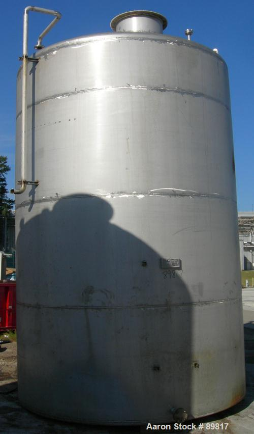 USED: Metal Equipment tank, approximately 6,760 gallon, stainless steel. Approximate 9' diameter x 14' straight side. Misc t...