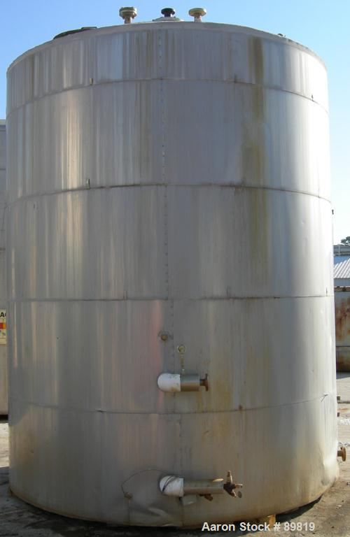 USED: Metal Equipment tank, approximately 7,000 gallons, stainless steel. Insulated. 10' diameter x 12' straight side. Flat ...