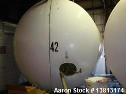 5,000 Gallon Mild Steel Exterior/Stainless Steel Tank. Interior previously used to store sweeteners...