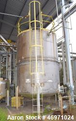 "Used- Southwest Tank & Treater Tank, 5000 Gallon, Stainless Steel, Vertical. Approximate 108"" Diameter x 136"" straight side,..."