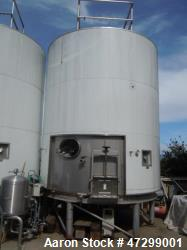 7,200 Gallon Stainless Steel Tank. Approximately 14' tall (with stands approximately 17'), 10' diam...